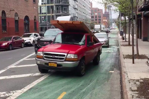 Cars and trucks drove through the Kent Avenue bike lane when the roadway was blocked by a truck.