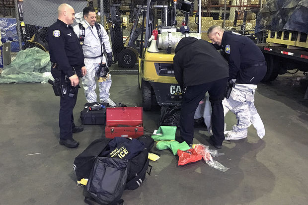 Port Authority Police Department ESU officers packed a drum leaking a noxious liquid into a safe container after it injured seven workers Friday morning, May 5, 2017.