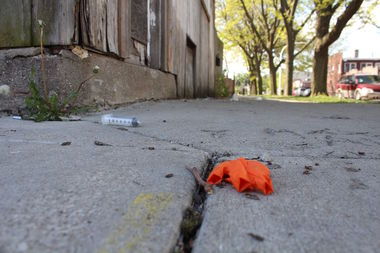 A paramedic's gloves and other supplies lay on the ground at the site of a Brighton Park shooting that killed two and injured eight Sunday night.