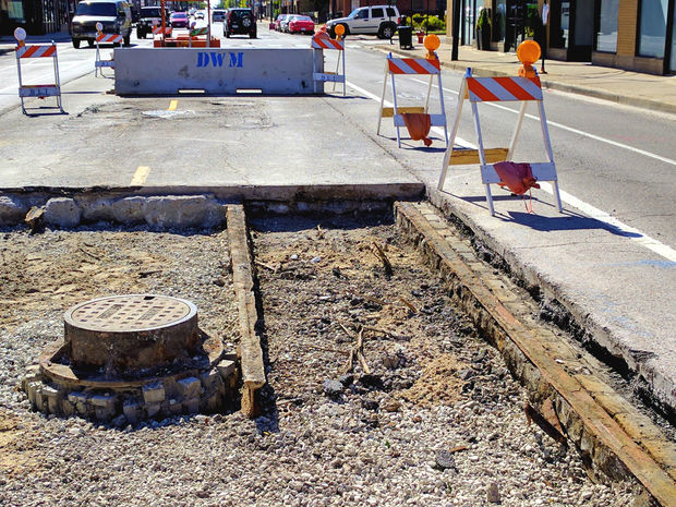 The city's streetcar past, buried just inches underground, was temporarily revealed on Lawrence Avenue.