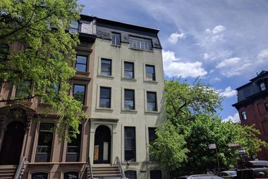 A Brooklyn man is accused of illegally seizing ownership of this home on Fort Greene Park, one of six Central Brooklyn properties he controlled through the use of fraudulent deeds, the Brooklyn District Attorney said.