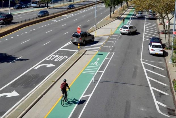 The plan to redesign Queens Boulevard includes the addition of bike lanes and stop-controlled slip lanes.