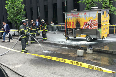 The cart's propane tanks ignited near Sixth Avenue Monday morning, officials said.