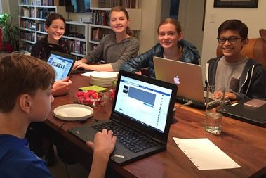 Hawkeye Pirtle (foreground) and Kelsey Bentrem (background, left to right), Calla Norsman, Ava Baldassari and Kiran Matthews are organizing a Children's March to empower young people like themselves.