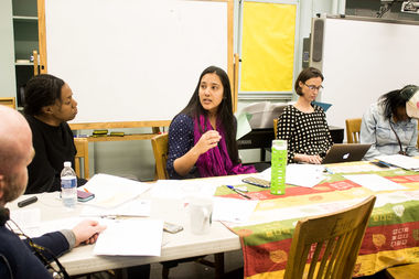 Monika Garg, center, speaks at a School Leadership Team meeting in April at Central Park East 1, where parents called for her removal.