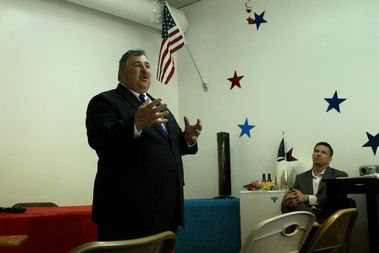 Fraternal Order of Police president Kevin Graham speaks to a meeting of the Northwest Side GOP Club, as club president Matt Podgorski listens.