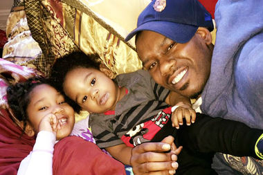 Jonathan Green smiles with his daughter and son.