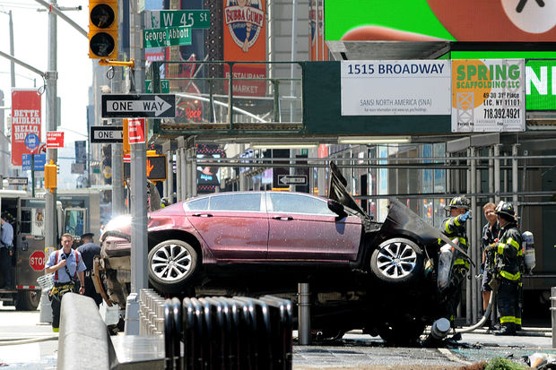 A maroon sedan jumped the curb injuring 13 people in Times Square.