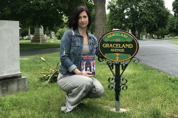 """Lindsay Currie has spent hours wandering through Graceland Cemetery. The walks provide Currie what she describes as """"solitude in the middle of a chaotic city,"""" but they also inspired her latest book """"The Peculiar Incident on Shady Street,"""" which is available for pre-order at major online retailers and will be officially released Oct. 10."""