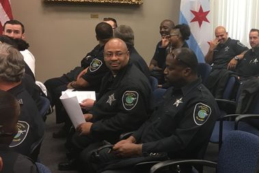 Dozens of city Aviation Department security officers asked aldermen to kill a plan to strip them of the authority to call themselves police.