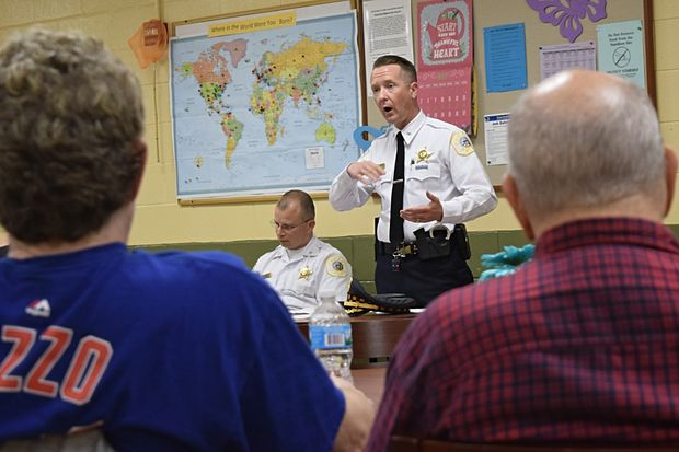 Cmdr. Sean Loughran spoke with Edgewater residents alongside Cmdr. Roberto Nieves at the Broadway Armory Monday night.
