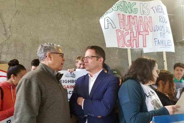 "Members of the Logan Square Neighborhood Association and Latin United Community Housing Association speak at a rally for ""The ""606 Residential Area Preservation Ordinance"" to be introduced to City Council on Wednesday and heard in June."
