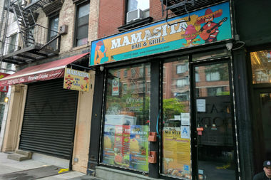 The pair were having dinner in Mamasita Bar and Grill on 10th Avenue when his gun went off, police said.