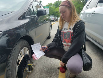 Christine Veit had her car booted after parking in a private lot in Wicker Park in May.