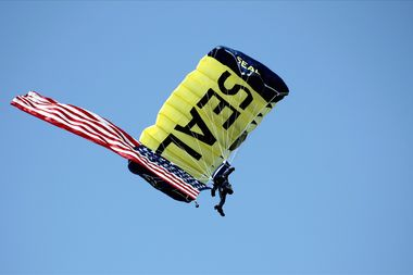 A member of the Navy SEAL parachute team the Leap Frogs jumps during an event at a stadium in April of 2011.