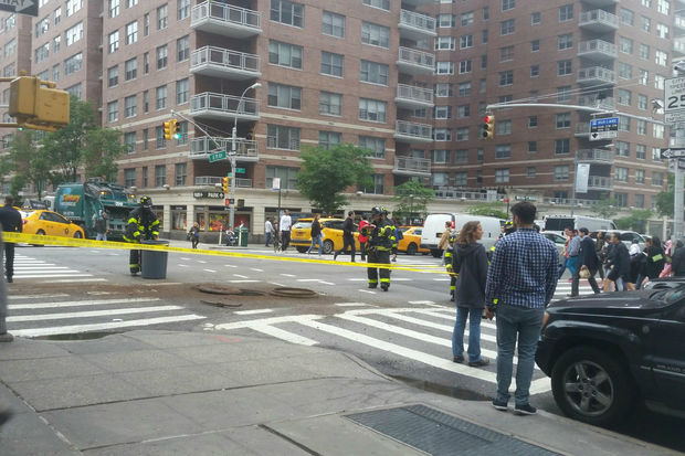 Five manholes caught on fire on the Upper East Side late Tuesday afternoon, causing at least one building to be partially evacuated and shutting down a stretch of First Avenue, the FDNY said.