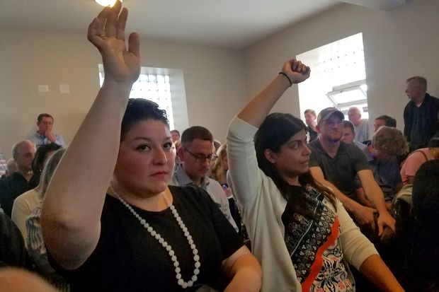 More than 100 residents showed up to a public meeting on Tuesday to express their opposition to a proposed 160 unit apartment project at Chestnut and Noble Streets in Noble Square.