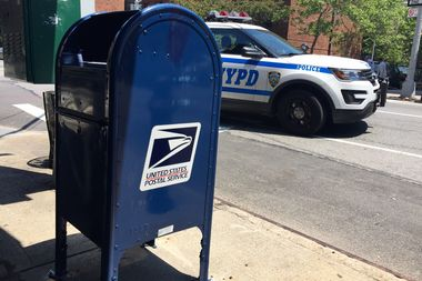 A modified mailbox in East Harlem at 120th and Lexington Avenue.
