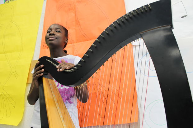 Turner has been teaching two students for almost four years how to play the harp, but many more want to learn as well.