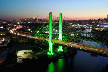 City Hall, One World Trade and the Kosciuszko Bridge were all adorned in green lights in support of the Paris Accord, which President Donald J. Trump announced the Unites States was backing out of.