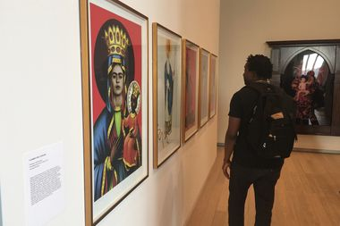 A patron browses the Uptown exhibition at the Lenfest Center for the Arts at Columbia University.
