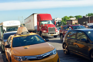 A truck waits in traffic near the Triborough Bridge in Astoria.