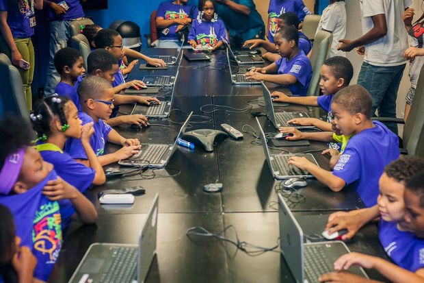 Kids use laptops during a children's program at BLUE1647, a tech center and co-working space in Pilsen.