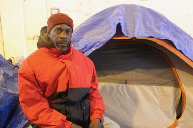 Bobby Williams in front of his tent underneath the Wilson viaduct.