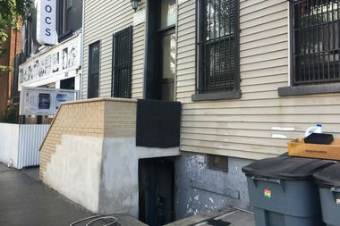 A man with neck and torso injuries was found dead at the bottom of an outdoor staircase leading to the basement of an apartment building, police said.