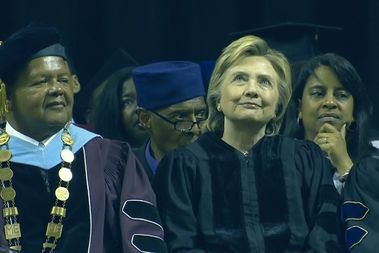 Hillary Clinton delivered the commencement address for Medgar Evers College in Brooklyn on Thursday at the Barclays Center. Here, she is seated before the speech next to the college's president, Rudy Crew, at left.