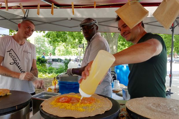 Fresh crepe preparation in action.