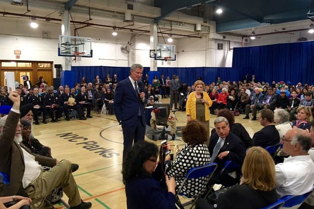 Mayor Bill de Blasio and Councilwoman Karen Koslowitz answer questions at a town hall held in Rego Park on June 8.