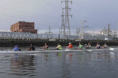 Members of the Lincoln Park Boat Club women's team practice on the south branch of the Chicago River near the Eleanor Boathouse.