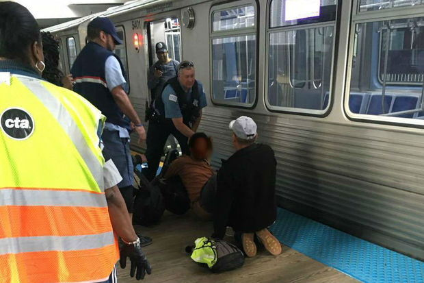A man was detained after allegedly stealing a woman's cellphone on the CTA Purple Line, and a witness said a man in a U.S. postal service uniform helped hold the man until police arrived.