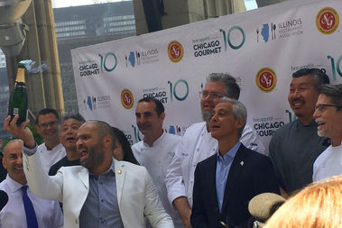 Sommelier Serafin Alvarado of Southern Glazer Wine & Spirits pops champagne as Mayor Rahm Emanuel and celebrity chef Rick Bayless usher in the 10th Chicago Gourmet festival. Tickets to the upscale food festival starring local chefs go on sale June 22.