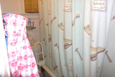 The shower inside Lynn Blue's apartment, which is too high for her disabled teenage daughter.