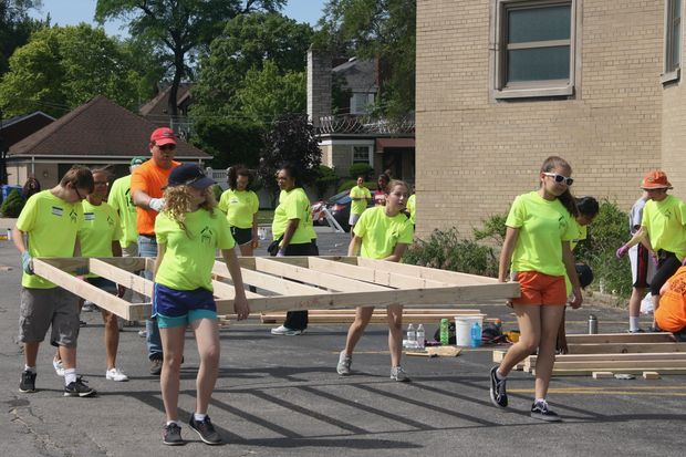Parishioners from St. Barnabas and Christ the King in Beverly worked together to build a home for a needy family last weekend. The house was shipped to Springfield, Ohio, complete with several messages left from the volunteer homebuilders.