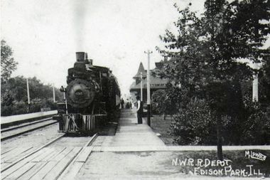 An early-20th Century snapshot of Edison Park residents boarding a train headed to Downtown
