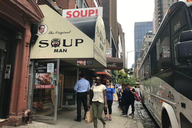 Loyal customers line up for soup in the middle of June.