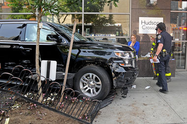 Nine people were injured when an SUV hopped the curb in Hell's Kitchen Thursday afternoon, officials said.
