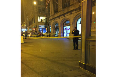 The scene after the shooting Thursday night at Michigan Avenue and Monroe Street. The 21-year-old victim was shot in the stomach and was