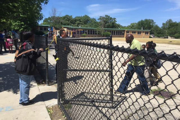 Two girls, 7 and 13 years old, were shot on the playground outside Warren Elementary on Friday, officials said.