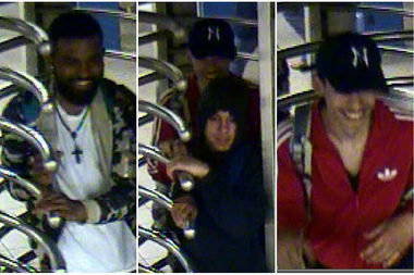 Police released this image of three suspects in an attack on a man inside the Roosevelt Avenue E and F train robbery.