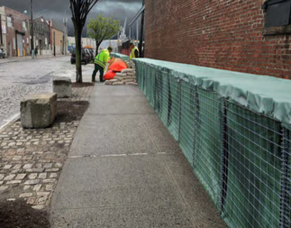 A Hesco barrier, sand-filled geotextile and wire mesh containers, will be built on the sidewalk along Beard Street, and remain there for at least several years.