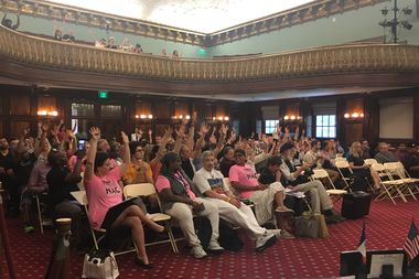 At a hearing Monday, those gathered to push city to repeal the Cabaret Law used jazz hands to support a speaker, as applause is not allowed in the City Council.