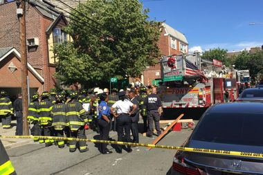 Three construction workers were injured after material fell from a boom lift and crashed through a home at 31-25 28th Rd. in Astoria Tuesday afternoon, authorities said.