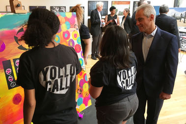 Mayor Rahm Emanuel (right) talks to students with Yollocalli Arts Reach on Thursday.