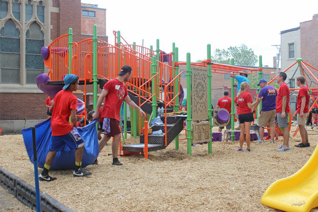 Volunteers and professional builders gave Augustus Tolton Catholic Academy students a new playground.