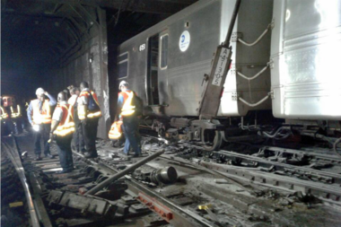 A sudden braking caused a train derailment in Harlem, injuring 34 people and causing massive transit disruption.