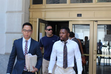 Gary Anderson, wearing white, leaves Brooklyn Criminal Court Wednesday. Anderson, 26, is accused of punching Domingo Diego-Tapia, 38, off his bike and causing Diego-Tapia to hit his head on the pavement, leaving him in a coma.